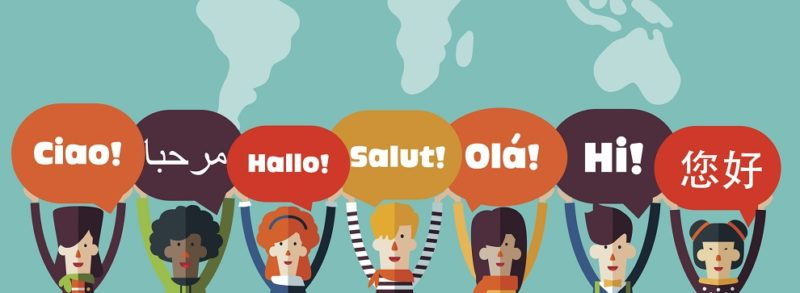 Group of happy people with speech bubbles in different languages